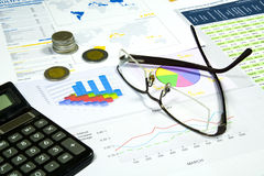Rising Costs, Finance Series. Calculator, glasses and money in finance analyzing royalty free stock image