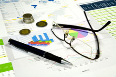 Rising Costs, Finance Series. Glasses, pen and money in finance analyzing royalty free stock photography