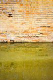 Rising damp on a brick wall in a channel full of water.  royalty free stock photos