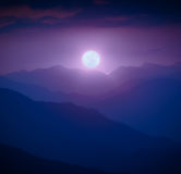 Rising of the full moon above the mountain valley Royalty Free Stock Image