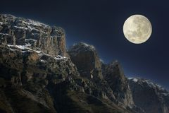 Rising full moon over the rocky summits. Rising full moon over the Pindus mountain range in north-west Greece stock images