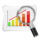 Rising Graph. Magnifying glass showing rising bar graph Royalty Free Stock Images