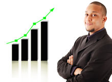 Rising Graph. This is an image of a businessman smiling due to a rise in profits, symbolised by the graph behind him Royalty Free Stock Photography