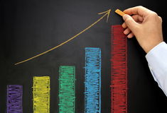 Rising graph with colorful chalk on blackboard Stock Photography