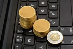 Rising Graph of Gold Coins Canadian Currency on keyboard.  stock images
