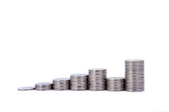 A rising graph made of coins. A rising graph made of silver coins stock photography