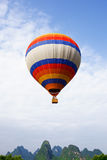 A rising hot air balloon Royalty Free Stock Photo