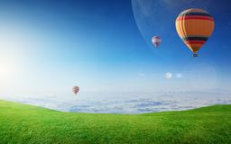 Rising hot air balloons in clear blue sky Stock Images
