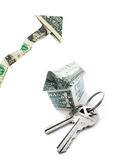 Rising housing prices. House keys and dollar house, with up arrow isolated on white   -- housing prices concept Royalty Free Stock Photo