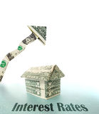 Rising Interest Rates. Money house with upward pointing dollar arrow and Interest Rates text Royalty Free Stock Photos