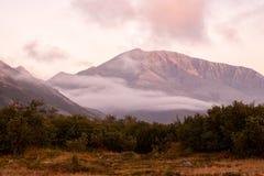 Rising mist in a mountain valley. Peninsula Kony. Magadan Region. Rus Royalty Free Stock Photos