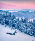 Rising moon above Gorgany ridge in winter Carpathian mountains. Stock Photos