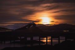 Rising moon over Atlantic Ocean Road in Norway stock photos