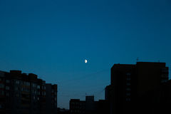 Rising moon over the city. Rising moon summer night over the city skyline Stock Photography