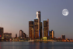Rising moon over Detroit, Michigan royalty free stock images