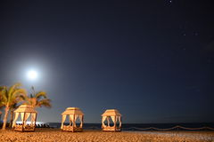 Rising moon over pacific ocean beach. Relaxing evening on the Los Cabos beach resort viewing rising moon with stars stock photo