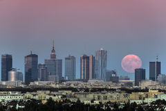 Rising moon over Warsaw city, Poland Royalty Free Stock Photo
