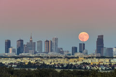 Rising moon over Warsaw city, Poland Royalty Free Stock Image