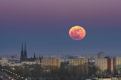 Rising moon over Warsaw city Stock Image