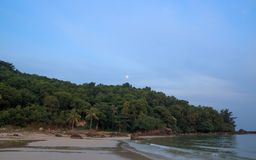 Rising moon, sea and tropical forest. Rising moon tropical forest sunset sea stock photos