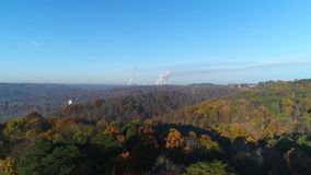 Rising morning countryside establishing shot Pennsylvania forest. A dramatic rising aerial establishing shot (DX) of a colorful late-Autumn Pennsylvania forest stock footage