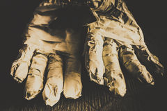 Rising mummy hands in bandage Stock Images