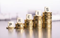 Rising price on coins. Rising stacks of coins with the word Price royalty free stock photo