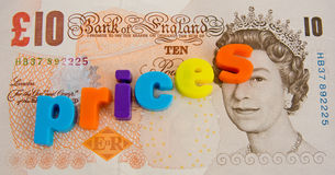 Rising prices: UK Pound Sterling. A macro concept image of rising prices shown on a ten pound note. Lower case colorful letters making the word ' prices ' Stock Images
