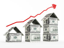 Rising red arrow above dollar shaped houses Royalty Free Stock Photos