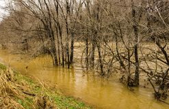 Rising Roanoke River Next to the Roanoke River Greenway. February 24th, 2019: A winter of the rising Roanoke River next to the Roanoke River Greenway located in royalty free stock image