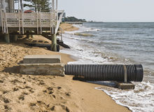 Rising sea levels. Erosion caused by rising sea levels due to global warming stock photos