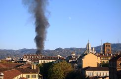 Rising smoke column in Turin Stock Photography