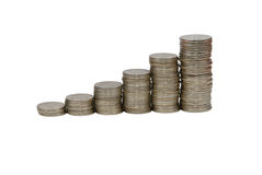 Rising stacks of coins. Ascent stacks of silver coins royalty free stock photography