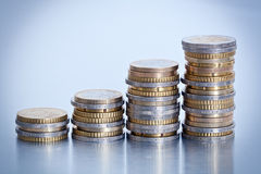 Rising stacks of coins. Euro coins arranged in stacks of increasing height Royalty Free Stock Photography
