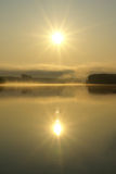 Rising sun. Reflexion in the river Royalty Free Stock Image