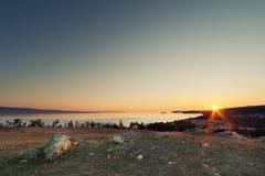 Rising sun on Baikal. Sunrise / sunset in Khuzhir, Olkhon island, Baikal Royalty Free Stock Photos
