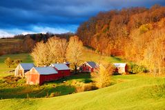 Daybreak on the Farm. A rising sun bathes a small farm and meadow in warm sunlight in late fall Stock Photography