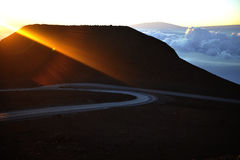 Rising sun beam. The beam  a rising sun has lit up top of a volcano of Haleakala on island Maui Stock Photos