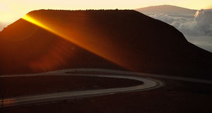 Rising sun beam. The beam  a rising sun has lit up top of a volcano of Haleakala on island Maui Stock Images