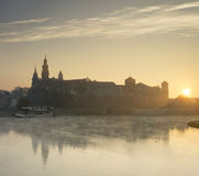 Rising sun behind castle on the river Royalty Free Stock Photo