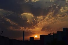 Rising Sun cached from my window. A beautiful View of Golden hour in cloudy sky stock images
