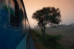 Rising sun from Indian rail. A train running towards horizon where sun is rising, Indian railway stock Image stock photography