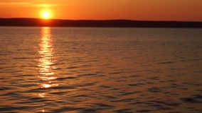 Rising of the Sun on lake stock video footage