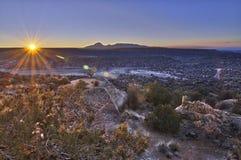 The rising sun lights up an ancient Anasazi ruin. Stock Photography