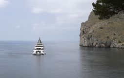 Rising sun megayacht in north coast of mallorca wide view. Rising Sun a 138 meters long megayacht owned by David Geffen anchored at Torrent de Pareis in the Stock Photography