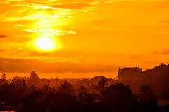 Rising sun in the morning. Rising sun in the morning with golden light with temple background stock photography
