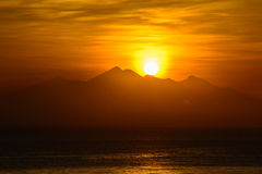 Rising sun from the mountain, Amed,  Bali Indonesia Sunrice on the sea Stock Image