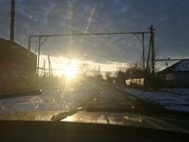 The rising sun over the Russian village. The view from the cab stock photo