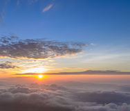 Rising sun over sea of mist Stock Image