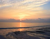 Rising Sun with Reflection in Ocean Water at Kalapathar Beach, Havelock Island, Andaman with Bright Colors in Sky. This is a photograph of sunrise at Kalapathar royalty free stock photos